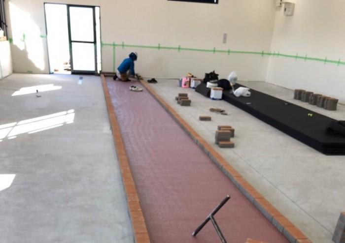 4レーン室内走路 全天候舗装材敷設工事